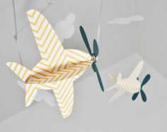 gah - in love. Baby Mobile, Airplanes in Yellow Chevron and  Teal. $36.00, via Etsy.