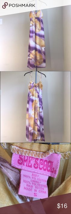 Purple and Yellow Long Flowing Dress Long floor length, light and flowing dress. It's has spaghetti straps with a great purple and yellow floral pattern. Lightly used. Dresses