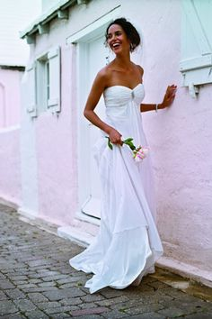 This strapless, empire waste gown was exactly what the bride was looking for to complete her beach look. Gown T9389 from David's Bridal's Galina collection.