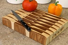 Handsome and rugged, this butcher-block-style cutting board is made entirely from pecan-hickory, a very hard & strong wood. The board is