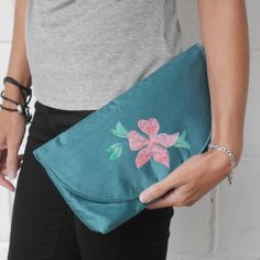 This elegant envelope style clutch bag is made from turquoise fabric and features an appliqued cactus on its flap. A lovely bag for a summer garden party or wedding reception. Occasion Bags, Clematis Flower, Turquoise Fabric, Fusible Interfacing, Romantic Evening, Summer Events, Summer Garden, Flower Making, Clutch Bag