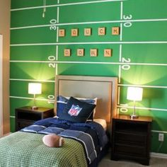 football painted on wall for sports theme room for my babys