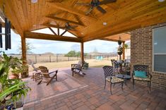 Beautiful covered patio designed and built by Backyard Retreats (281)485-8483