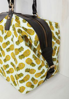 Ripe for the Traveling Weekend Bag. Whether road tripping to the beach or jetsetting to the tropics, this pineapple printed weekend bag will bring the quirk! #multi #modcloth