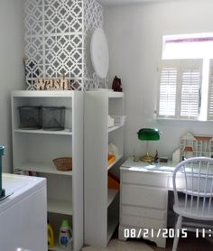 Hide water heater with cheap laminate bookcases - up cycled with chalk paint & beadboard wallpaper.