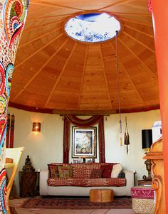 Solaria earthship where I stayed last weekend near Taos, NM - skylight is surround by mirror mosaic to reflect light around living room