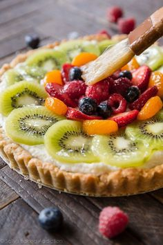 We've got fresh fruit tart on the dessert menu today! I've been waiting for the weather to warm up to make, shoot, and post this beauty. It's been gray and rainy all month, but when the sun finally showed up– I broke out my hand mixer, chopped up a million pounds of fruit, and decided mascarpone …