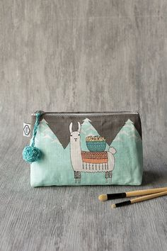 The Llamarama small cosmetic bag is perfect for storing makeup, toiletries, accessories, craft supplies and more. Small Cosmetic Bags, Travel Toiletries, Floral Necklace, Cat Design, Bago, Beauty Essentials, Small Bags, Zipper Pouch, Travel Style