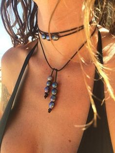 Super sexy conversation piece, one of our best sellers. this necklace gets lots of attention Bolo tie necklace Fresh water pearls on leather Adjustable can be w