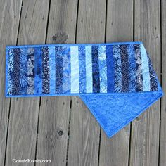 Tutorial for a Skinny Blue Batik Tablerunner that is a great way to use up some of the batiks in your stash. This is a fast and easy quilt project that you'll enjoy making. Patchwork Table Runner, Baby Patchwork Quilt, Table Runner And Placemats, Quilted Table Runners, Table Runner Tutorial, Table Runner Pattern, Diy Sewing Projects, Quilting Projects, Quilting Ideas