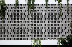 Perforated brick facade shades House for a Daughter in Vietnam