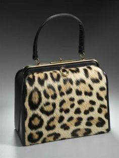 1950s black leather frame handbag with front and back panels of leopard skin.