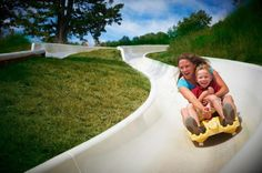 The slide is available for use by anyone over the age of three, though young children are required to ride tandem with a parent or other adult.
