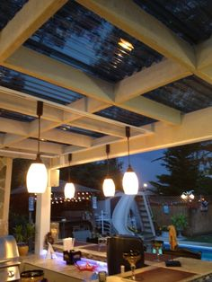 covered pergola love the roofing material...let's int he light but keeps the shade. Screen it it for a wonderful area by sunroom.