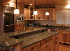 Cozy Lowes Quartz Countertops for Your Kitchen Design Ideas: Traditional Kitchen Design With Lowes Quartz Countertops And Oak Kitchen Cabinets With Under Cabinet Microwave And Pendant Lighting Plus Solid Surface Countertops