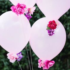 Add dollar store flowers to the bottom of balloons for a gorgeous effect - perfect for Mother's Day, weddings, showers, or summer parties!