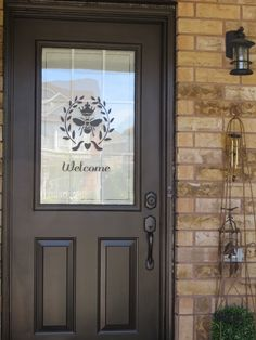My new front door - A coat of paint and some personality ... Benjamin Moore paint colour Black Bean Soup - Semi Gloss finish, Oil rubbed bronze hardware and an incredible WELCOME ... love this !!!  www.anneshomeandgarden.com Facebook Anne's Home & Garden