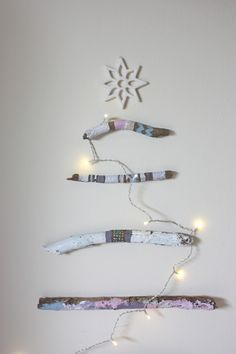 Wall driftwood stick Christmas tree idea.