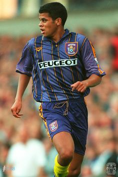 Marcus Hall wears the purple and gold away kit from the season. Coventry City Fc, Blue Army, Football Uniforms, The Past, Blues, Sky, Defenders, History, 20 Years