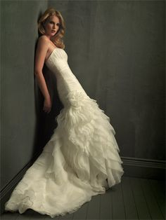 Visit Vera's House of Bridals in Madison, Wisconsin to try on this and similar dresses today! For specific dresses please call ahead, as our inventory changes daily!