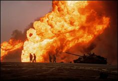 U.S. Marines in front of the burning Burgan oil fields, 1991. Iraq invaded Kuwait on Aug. 2, 1990. The Allies intervened under Operation Desert Storm.
