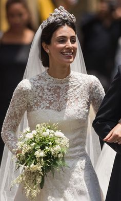 14 March 2018 - Fashion designer Alessandra de Osma looked stunning in a gown by Jorge Vázquez as she married Prince Christian of Hannover in Peru. The high neck wedding dress featured long lace sleeves and a lengthy train and was complemented with her hair pulled back and a long veil. She topped it with the Hanover Floral Tiara.