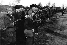 Russia, Bryansk region, 1943: Freshly recruited partisans fall in on the day of the formation of their unit. Like most partisans during WW2, they are most likely under the command of a regular Red Army officer.They are armed with weapons that are standard issue for the Red forces of the time, including the ubiquitous PPsh-40 SMG.By the end of the war more than 2 million partisans had taken to the field against the Germans.