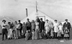 Striking family at Ludlow shortly before the April 20, 1914 massacre. 11,000 miners working for the Colorado Fuel & Iron Corporation, owned by the Rockefeller family, went on strike against low pay, dangerous conditions. Gunmen were hired by the Rockefellers. The governor called the National Guard,  the Rockefellers paid their wages. The miners thought the Guard would protect them, but it was there to destroy them.