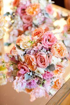 garden roses, ranunculus, peonies, lambs ear, and silver brunia