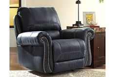 It's all in the details. And the Milhaven power rocker recliner truly nails it with fashion forward elements including a picture frame bustle back, nailhead trim, padded, rolled arms and overstuffed cushions throughout. Contrast overstitching gives this piece the presence to sit comfortably in the living room or family room while faux leather upholstery stands up to your lifestyle with ease.