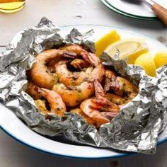 Garlic Grilled Shrimp -- Foil wrapped grilling is easy to do, easy to clean, and so good to eat. You control the heat index on this dish, so make it light or crank it up! Shrimp Recipes, Fish Recipes, Grilling Recipes, Cooking Recipes, Cooking Food, Grilling Ideas, Cooking Tips, Shrimp In Foil Packets, Foil Packet Meals