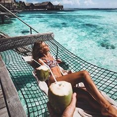 cheers @keeevsch a coconut a day keeps the doctor away #maldives #couple #summer