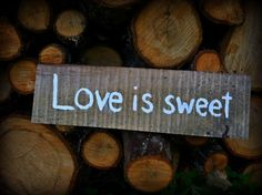 Love is sweet rustic wedding sign by SawmillCreations on Etsy, $15.00