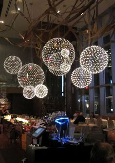 Aria Ristorante Restaurant in Toronto  Designed by --> Architect Stephen Pile  --> spherical Moooi light fixtures