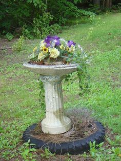 Birdbath spilling over with flowers