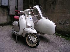 Not a vespa, a Lambretta sidecar!