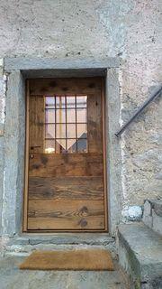 Portone d'ingresso duoble-face:abete antico e larice anticato . www.casalegnoantico.it  #italianoldwooddesign #altholzbau #legnovecchio #legnodirecupero #ValleAntrona #Ossola #Expo2015