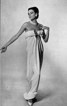 Model in luxurious gown of white crêpe draped from white mink bodice down to white mink hem by Christian Dior, photo by Georges Saad,1965