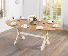 Buy the Bordeaux 165cm Oak and Cream All Sides Extending Table at Oak Furniture Superstore