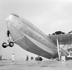 Saunders Roe SR.45 Princess flying boat being serviced or scrapped (minus propellers). The largest flying boat ever constructed, with ten turboprop engines driving 6 pods of propellers. 3 were ordered & built for BOAC, but only one flew. The age of the flying boat was ending when the first took to the air, in 1952. The order was cancelled and the 3 were scrapped after approaches to the RAF & USAF for their use as transports failed.