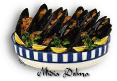 ARMENIAN MIDIA DOLMA - STUFFED MUSSEL DOLMA. Made with fresh or canned mussels. An extraordinary appetizer. This can be eaten hot or cold.