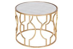 Stylish side table could use 2 in center as an alternative to a coffee table