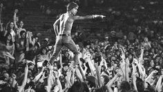Iggy Pop crowd surfing like a boss at a concert in Cincinnati 1970
