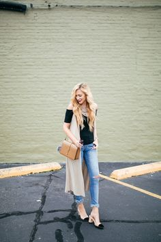 A Pinch of Lovely. Black off the shoulder top+cropped jeans+black and nude pumps+camel shoulder bag+nude long vest. Summer Outfit 2016