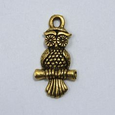 brass charm in antique brass, antique silver and antique gold color plating. Cute, very detailed owl sitting on a branch with two sides. Loop at the top. Jewellery Making Materials, Seed Beads, Antique Silver, Belly Button Rings, Plating, Owl, Etsy Shop, Crystals, Stone