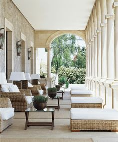 What a gem of a porch! Terrific furnishings and stunning architecture!
