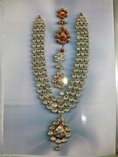 3line big daimond polki and beck side minaakri(enemal)work kundan jadau gold