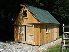 Mini-Barn Shed---something like this to keep sheep and goat in at night during our frigid winters :)