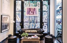 WALL ART...Cassandra Grey on Reinventing the Beauty Biz - Cassandra and Bill Sofield had the idea to graffiti the lounge area windows in French script, which was painted by John Opella. The print hanging in front is by Guy Bourdin, and the photograph and the sketch are by Edith Head.