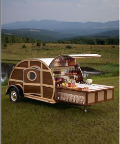 Neiman's ultimate tailgate trailer -I wonder if Santa will bring this to me....